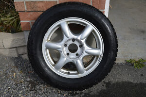 4 Buick Regal 225/60R16 Alloy rims with Gislaved snow tires