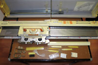 Knitting machine, accessories and table