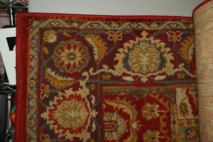 RUG  5.3 X 7.7 FT WITH UNDERPAD  $200