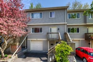 Over 2000 sq.f. 3 Bedrooms, 3 Baths Condo backing on green space