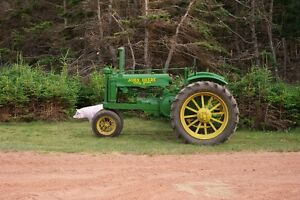 Huge haul of antique Jonh Deere Tractors