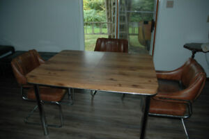 Beautiful Solid Table & 3 leather Chairs