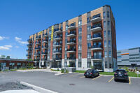 1 bedroom condo ** Pool ** Gym ** steps to train ** Vaudreuil**