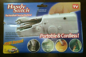 The handheld sewing machine (brand new)
