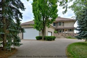 LARGE CUSTOM 2 STOREY WITH 70' OF RIVERSIDE DR. WATERFRONT