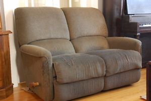 FREE!  Two Reclining Love Seats perfect for students or cottage