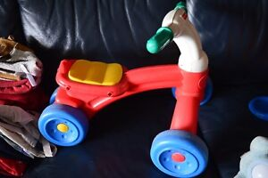 Petit tricycle fisher price
