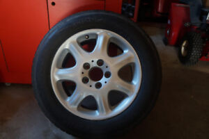 FOUR ALLOY WHEELS AND TIRES