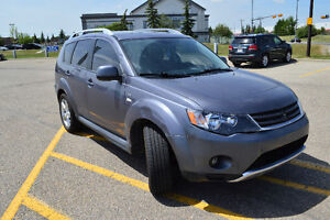 2009 Mitsubishi Outlander XLS, leather, moon roof, 7 seater.
