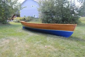Handcrafted wooden row boat