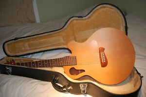 6 string acoustic Tacoma Guitar and case