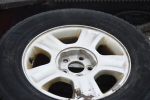 ALL SEASON TIRES  WITH RIMS OFF 2001 FORD ESCAPE 235-70-16