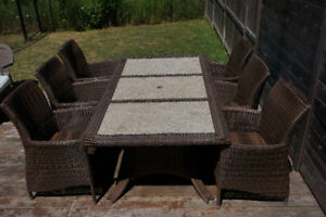 Six person granite and wicker outdoor table/dining set/patio set