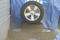 """Stock Dodge 20"""" tires and Dodge rims NEW."""