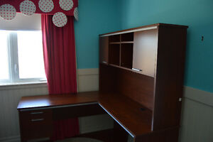 Almost new L-shaped desk with bookshelf!