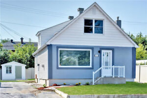 Completely renovated and vacant 1.5 storey home with in-law suit