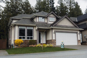 6 bed 4 bath Executive home with a suite backing onto greenspace