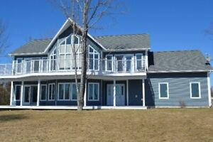 CUSTOM BUILT, CHALET STYLE HOME - DEEDED WATERFRONT PROPERTY!!