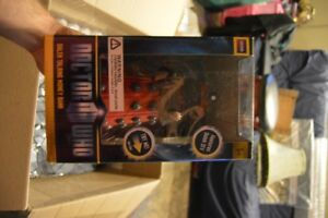 Doctor Who Taking Red Dalek piggy bank