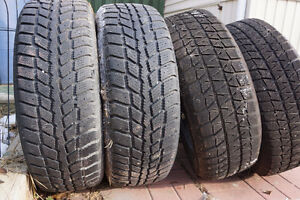 Four 16x225 Winter Tires, on Steel rims, 1 year use, $300