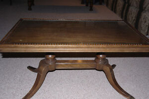 Antique coffee table with glass inset top and claw feet