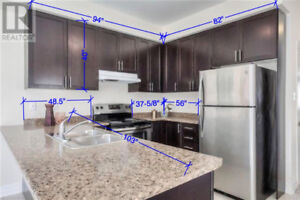 Kitchen Cabinets with counter, Sink, and faucet