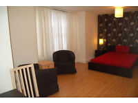 Good Size Room with Grand windows Shared bathroom and kitchen in Lancaster Gate W2