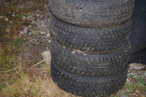 Studded tires on Toyota rims for sale