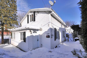 Cute starter home for sale steps to the waterfront in Dorval
