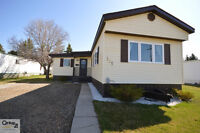 UPDATED mobile home with beautiful curb APPEAL!