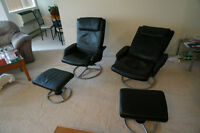 2 Black reclining chairs with footstools