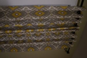4 panels of curtains.  grey and yellow