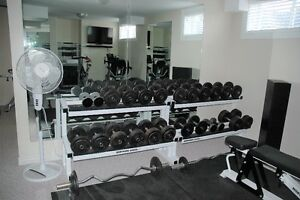 A Full Set of Dumbells and Two Dumbell Racks