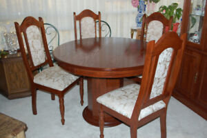Four foot Round Wooden Table with four upholstered chairs