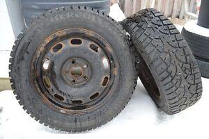 "2 15"" snow tires on VW Jetta 5 bolt steel rims Belleville Belleville Area image 1"