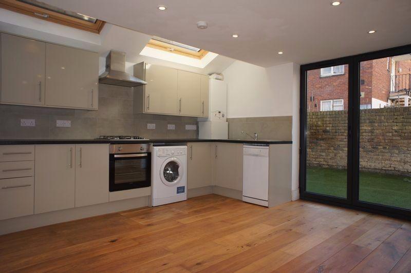 This Newly refurbished split level garden flat