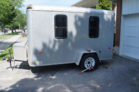 Enclosed Utility Trailer for Work and Play with Papers