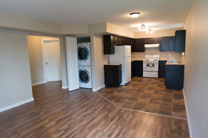 Spacious 2 bed ground level suite - private entrance and laundry