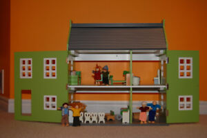 Dollhouse (doll house) with furniture and family figures