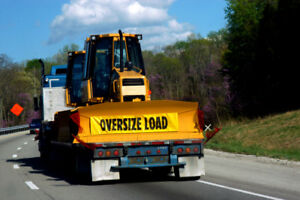 Shipping heavy equipment and car in Ontario