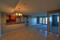 Airdrie: 2 bed/2 bath condo with lovely creek view