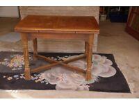 Extending oak dinning table in need of a little tlc.