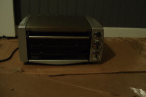 four grille pain delonghi a convection de comptoir