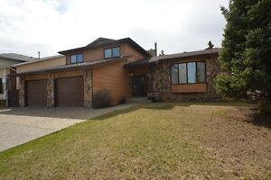 LOCATION! Need to SEE this 2130 sq ft, Completely Developed Home