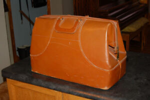 mans old leather overnight bag