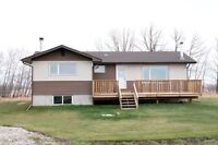 Acreage with home and shop near Strathmore