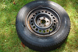 Four lightly-used MotoMaster all-season tires for sale