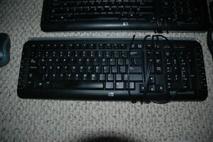 2 keyboards and 2 wireless mice and surge bar London Ontario image 2