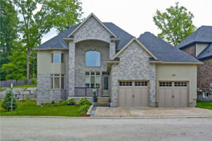 Your Dream Home.....Nestled in a private treed enclave.