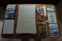 Wii + Wii Fit Plus With Balance Board + 3 other Games.